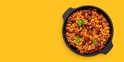 Chili con carne in frying pan on dark  background. Ingredients for making Chili con carne.  Top view.  Mexican Texas traditional dish