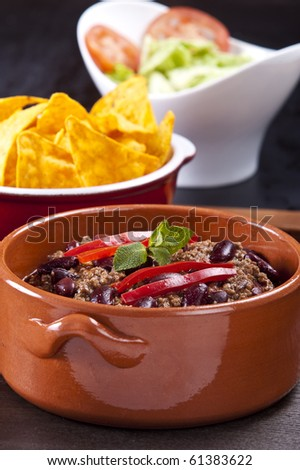 Chili con carne on white background with shadows