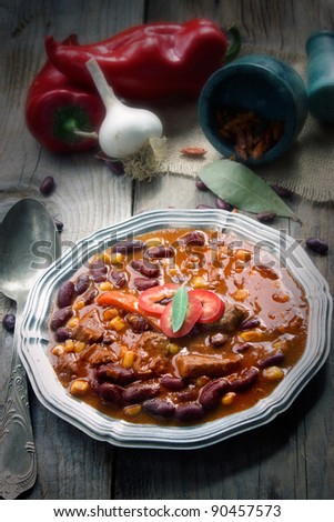 Chili con carne plate. Mexican traditional dish in rustic setting