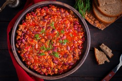 Chili con carne, traditional Mexican dish with beef and beans, top view