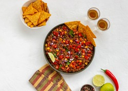 Chili con carne with nachos chips. Mexican food. National cuisine