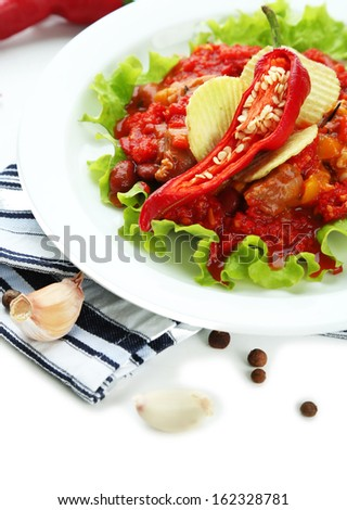 Chili Corn Carne - traditional mexican food, on white plate, on napkin, isolated on white