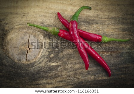 Chili Peppers /  Chili peppers isolated on wood texture