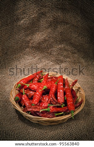 chili peppers on the wicker dish, sacking background