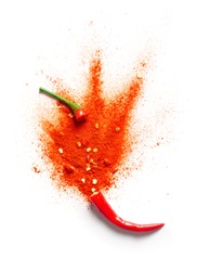 Chili powder bursting out of a red chili pepper