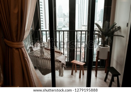 Chilled and relaxed style balcony with a cradle in condominium  #1279195888