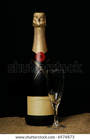 chilled bottle of champaign on black
