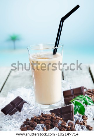 Chilled cafe mocha on ice enjoyed through a straw for a refreshing drink