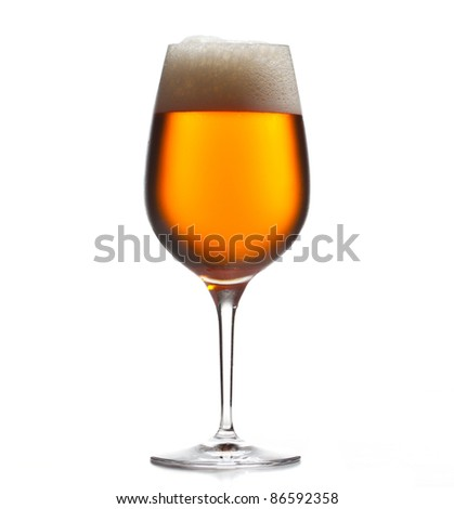 Chilled isolated wine goblet with small droplets of condensation on the outside of the glass and filled with golden colored beer