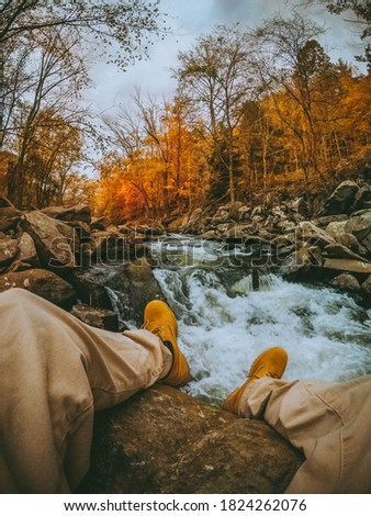 Chillen by the River on a Fall Day Stockfoto ©
