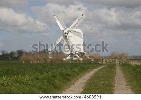 Chillenden Post Mill, in Kent, under cloudy and blue skies.Built in 1868 probably one of the last windmills built in Kent. Destroyed after Storms and reconstructed with National Lottery funding