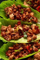 Chilli Beef Lettuce Wraps with sauce on black plate