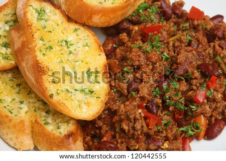 Chilli con carne served with garlic and herb bread