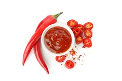 Chilli pepper and bowl of sauce isolated on white background