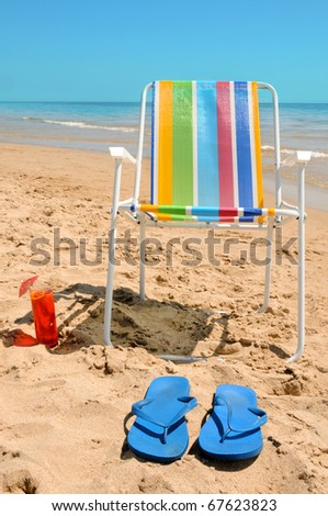 chilling out with a cocktail on the beach - stock photo