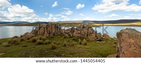 Chilly lakes and snow tundra plains and hills and rocky tors of the Snowy High Plains Kosciuszko National Park panorama of 7 images stitched