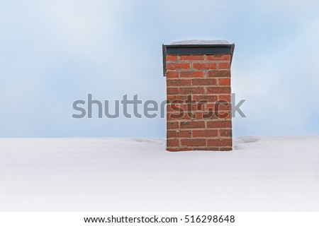 Chimney in red bricks with white snow on roof. Detailed view from Sweden.