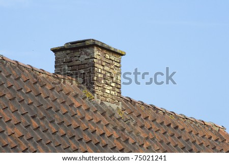Chimney on a roof of an old residential house