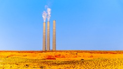 Chimneys of the soon to be decommissioned Salt River Project - Navajo Power Station in the desert landscape near Page, Arizona. One of the three units was already decommissioned in the fall of 2019