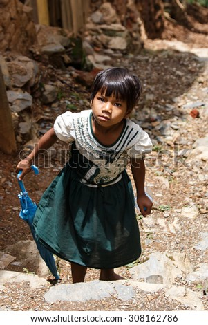 CHIN STATE, MYANMAR - JUNE 18 2015: Cute school girl in the recently opened for tourists Chin State Mountainous Region, Myanmar (Burma)