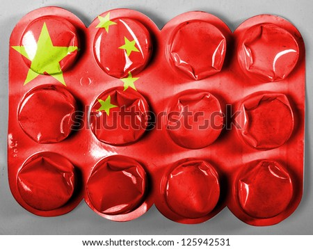 China. Chinese flag  painted on tablets or pills