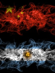 China, Chinese vs Argentina, Argentinian, Argentine smoky mystic flags placed side by side. Thick colored silky abstract smoke flags.