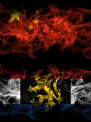China, Chinese vs Benelux smoky mystic flags placed side by side. Thick colored silky abstract smoke flags.
