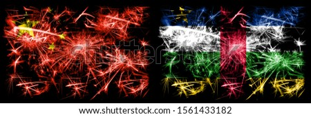 China, Chinese vs Central African Republic New Year celebration travel sparkling fireworks flags concept background. Combination of two abstract states flags.