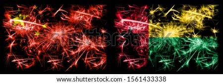 China, Chinese vs Guinea Bissau New Year celebration travel sparkling fireworks flags concept background. Combination of two abstract states flags.