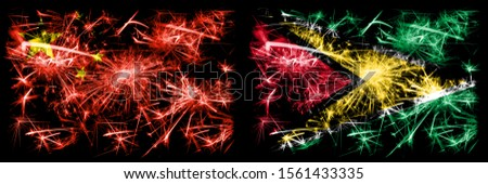 China, Chinese vs Guyana, Guyanese New Year celebration travel sparkling fireworks flags concept background. Combination of two abstract states flags.