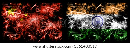 China, Chinese vs India, Indian New Year celebration travel sparkling fireworks flags concept background. Combination of two abstract states flags.