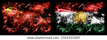 China, Chinese vs Kurdistan, Kurdish New Year celebration travel sparkling fireworks flags concept background. Combination of two abstract states flags.