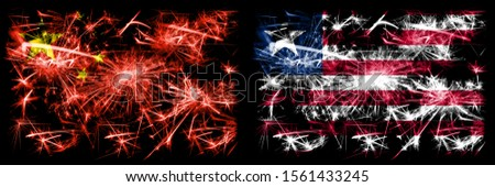 China, Chinese vs Liberia, Liberian New Year celebration travel sparkling fireworks flags concept background. Combination of two abstract states flags.