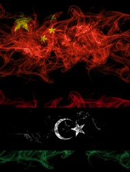 China, Chinese vs Libya, Libyan smoky mystic flags placed side by side. Thick colored silky abstract smoke flags.