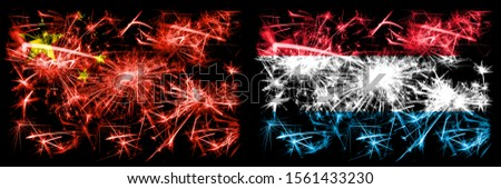 China, Chinese vs Luxembourg New Year celebration travel sparkling fireworks flags concept background. Combination of two abstract states flags.