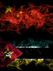 China, Chinese vs Mozambique, Mozambican smoky mystic flags placed side by side. Thick colored silky abstract smoke flags.