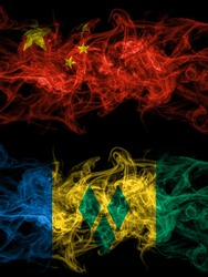 China, Chinese vs Saint Vincent and the Grenadines smoky mystic flags placed side by side. Thick colored silky abstract smoke flags.
