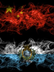 China, Chinese vs San Marino smoky mystic flags placed side by side. Thick colored silky abstract smoke flags.