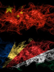 China, Chinese vs Seychelles, Seychellois smoky mystic flags placed side by side. Thick colored silky abstract smoke flags.