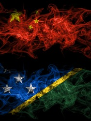 China, Chinese vs Solomon Islands smoky mystic flags placed side by side. Thick colored silky abstract smoke flags.