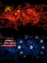 China, Chinese vs United States of America, America, US, USA, American, Easton, Pennsylvania smoky mystic flags placed side by side. Thick colored silky abstract smoke flags.