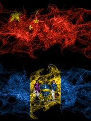 China, Chinese vs United States of America, America, US, USA, American, Philadelphia, Pennsylvania smoky mystic flags placed side by side. Thick colored silky abstract smoke flags.