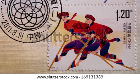 CHINA - CIRCA 2011:A stamp printed in China shows image of Traditional Sport of Minority,circa 2011