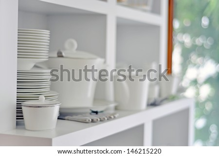 China dish, tableware and cutlery in a bright kitchen