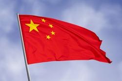 China flag isolated on sky background. close up waving flag of China. flag symbols of China.