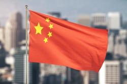 China flag on cityscape background