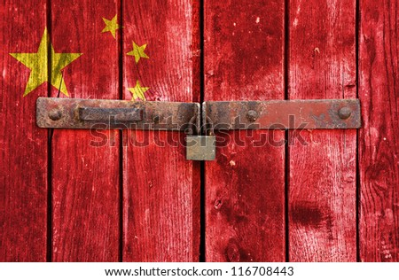 China flag on the background of old locked doors