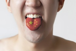 China flag painted in tongue of a man - indicating Chinese language and speaking