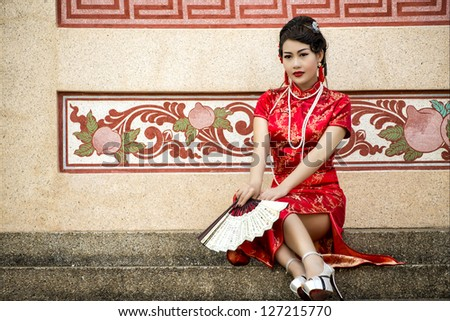 China Girl,Chinese woman red dress traditional cheongsam ,close up portrait