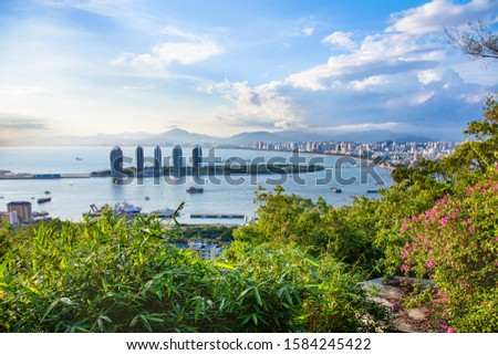 China Hainan Island Landscape Sunset Sea View Travel tropical coastline with bay, clouds and palm leaves